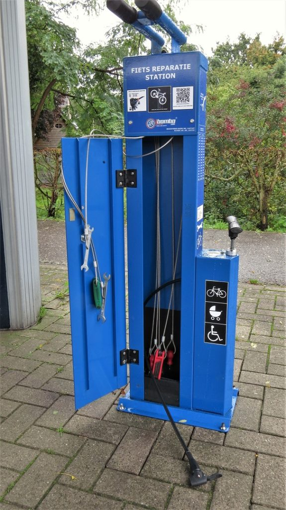 Bicycle repair tools and pump together in a blue box